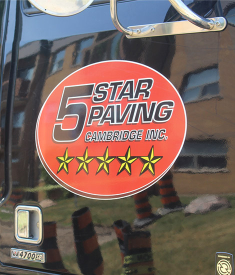 Five Star Paving logo on a black truck
